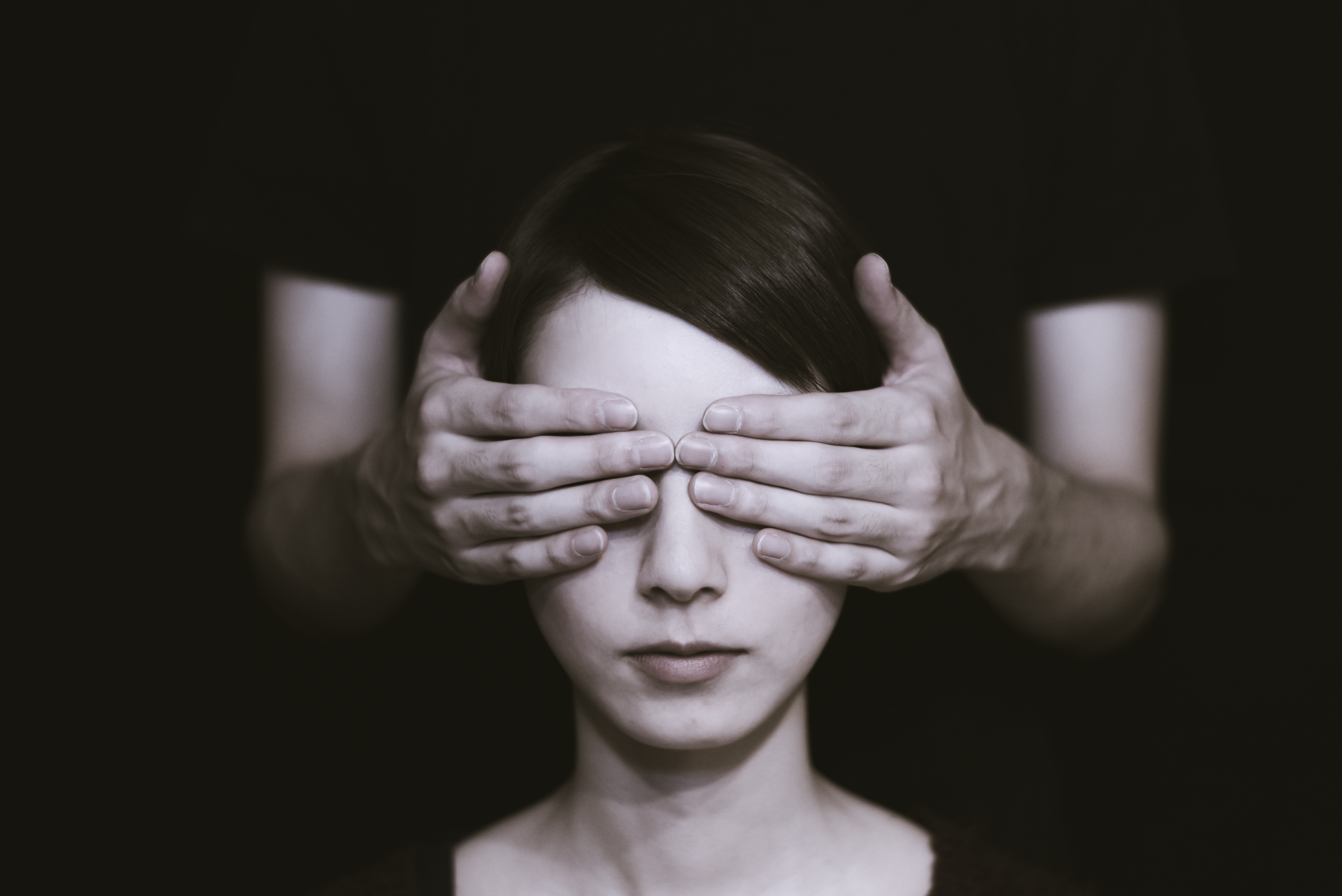 Woman with hands over her eyes