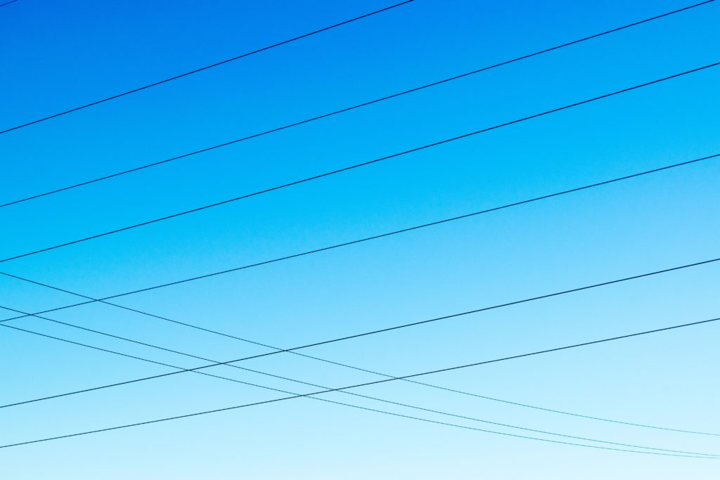 Telephone wires, blue sky