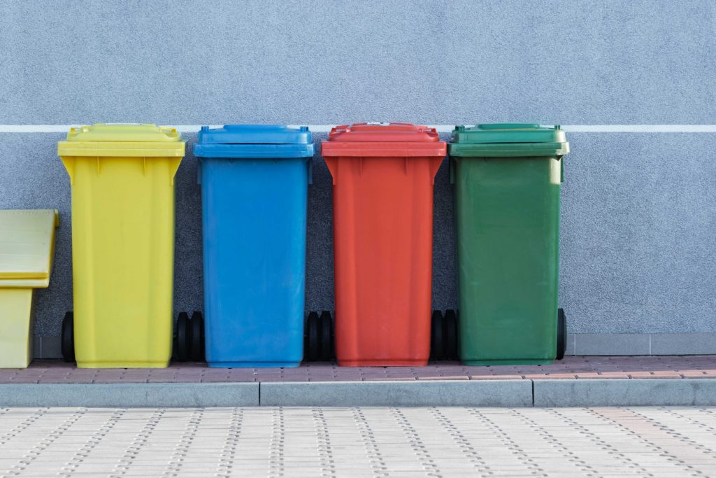 Recycling bins in primary colours