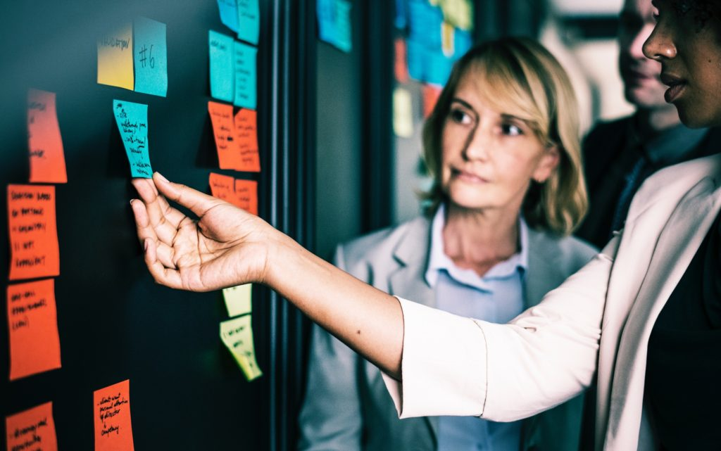 women with sticky notes business meeting